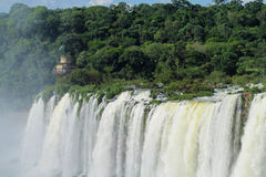 Iguasu waterfalls. Iguazu Falls, Iguassu Falls, Cataratas do Iguacu, Cataratas del Iguazu. Waterfalls of the Iguazu River Huge streams of water spray Royalty Free Stock Photos