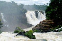 Iguasu waterfalls. Iguazu Falls, Iguassu Falls, Cataratas do Iguacu, Cataratas del Iguazu. Waterfallsof theIguazu River Huge streams of water spray Royalty Free Stock Photo