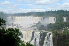 Iguasu waterfalls. Iguazu Falls, Iguassu Falls, Cataratas do Iguacu, Cataratas del Iguazu. Waterfallsof theIguazu River Huge streams of water spray Royalty Free Stock Image