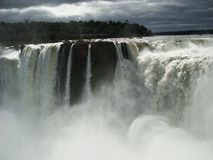 Iguazú Falls. View of the Iguazú falls in a cloudy day with an unusual caudal of the river. In the background you can see the jungle Stock Photo