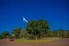 IGUAZU, ARGENTINA - MAY 14, 2016: argentinas flag waving at the national park of iguazu Royalty Free Stock Images