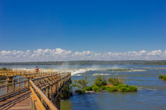 IGUAZU, ARGENTINA - MAY 14, 2016: nice view of the top of the waterfalls in the argentinian side, blue sky as background.  Royalty Free Stock Images