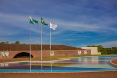 IGUAZU, BRAZIL - MAY 14, 2016: the brazilian flag next to the state and city flags at the entrance of the iguazu Stock Photography