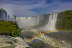 IGUAZU, BRAZIL - MAY 14, 2016: nice rainbow formed with the mist of the main fall called devils throat Royalty Free Stock Photography