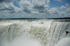Iguazu Devil's Throat. Massive high water flows into the Devil's Throat section of Iguazu Falls, Argentina & Brazil Stock Photos