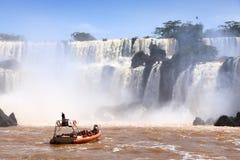 Iguazu Falls boat. IGUAZU NATIONAL PARK, ARGENTINA - OCTOBER 10, 2014: People enjoy boat tour of Iguazu National Park in Argentina. The park was established in Stock Images