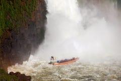 The Iguazu Falls. Boat near the Iguazu Falls (Cataratas del Iguazu), waterfalls of the Iguazu River on the border of the Argentina and the Brazil Stock Image