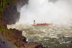The Iguazu Falls. Boat near the Iguazu Falls (Cataratas del Iguazu), waterfalls of the Iguazu River on the border of the Argentina and the Brazil Stock Photography