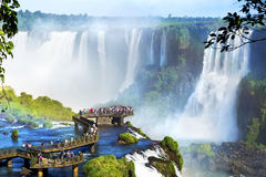 Iguazu Falls, on the border of Argentina and Brazil. Tourists at Iguazu Falls, one of the world's great natural wonders, on the border of Brazil and Argentina Royalty Free Stock Photography