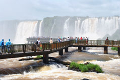 Iguazu Falls in Brazil with tourists. The famous landmark waterfalls National Park Foz do Iguaçu in Brazil Royalty Free Stock Photography