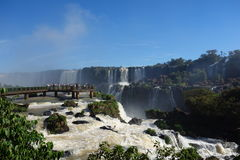 Iguazu Falls on the Brazilian side. Beautiful picture of people enjoying the Brazilian side of Iguazu Falls on a clear summers day Stock Photo