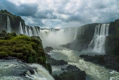 Iguazu falls in a cloudy day. Iguazu falls in Argentina with clouds Stock Photos
