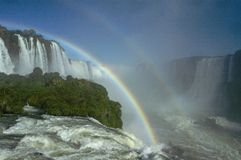 Iguazu Falls with double rainbow a bright sunny day stock images