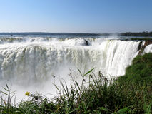 Iguazu Falls. Iguaçu Falls is one of the seven natural wonders of the world. It is located on the border of Brazil and Argentina and is the largest waterfall stock images