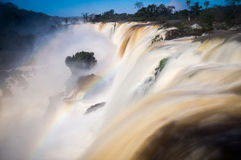 Iguazu Falls with rainbow, Argentina. View of the world-famous Iguazu Falls in Argentina with a rainbow Royalty Free Stock Photos