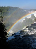 Iguazu Falls and rainbow. Iguaçu Falls is one of the seven natural wonders of the world. It is located on the border of Brazil and Argentina and is the royalty free stock photography