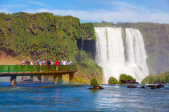 The Iguazu Falls. Tourists near the Iguazu Falls, waterfalls of the Iguazu River on the border of the Argentina and the Brazil. It's one of the New 7 Wonders of Stock Photo