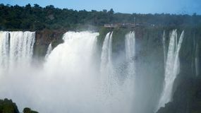 Iguazu Falls Waterfall with Rainbows and Spray as seen from the Brazil Side.  Stock Photo