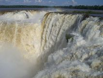 Iguazu Waterfall. Beautiful scene of a wonder of nature: the waterfall of the Iguazu river located right at the border of the countries of Argentina, Brazil and Stock Photos