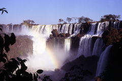 Iguazu waterfalls. View of the Iguazu falls. Iguassu Falls is the largest series of waterfalls on the planet, located in Brazil, Argentina, and Paraguay. At some stock photography