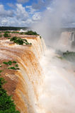 Iguazu waterfalls in Argentina. Vertical view with raibow stock photos