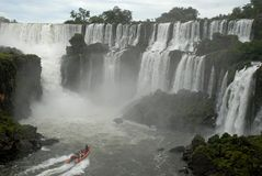 Iguazu waterfalls - Argentina. Iguazu waterfalls and boat with people Royalty Free Stock Images