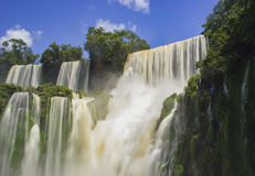 Iguazu waterfalls long exposure lid up by sun, Argentina. Using a long exposure giving this silky, smooth feel to one of the most impressive waterfalls of the royalty free stock photos
