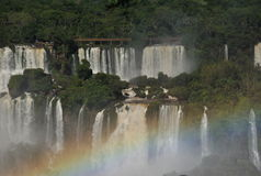 Iguazu Waterfalls with rainbow. Frontal view of the Iguazu waterfalls with a rainbow in the right side bottom Stock Photo