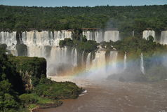Iguazu Waterfalls with rainbow. Broad view of the Iguazu waterfalls with a rainbow in the right side bottom Royalty Free Stock Photography