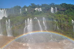 Iguazu Waterfalls with rainbow. Broad view of the Iguazu waterfalls with a rainbow in the right side bottom Royalty Free Stock Photo