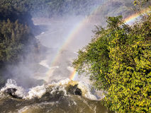 Iguazu Waterfalls Rainbow. Iguazu Iguacu falls, largest series of waterfalls on the planet, located between Brazil, Argentina, and Paraguay with up to 275 Royalty Free Stock Photos