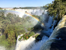Iguazu Waterfalls Rainbow. Iguazu Iguacu falls, largest series of waterfalls on the planet, located between Brazil, Argentina, and Paraguay with up to 275 stock photo