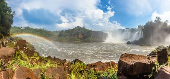 Iguazy Falls panorama with waterfalls cascades steam and rainbow Royalty Free Stock Image