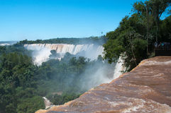 Iguazzu Falls. South America. Tourists view the famous waterfalls on the border of Argentina and Brazil Royalty Free Stock Photos