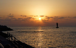 Заход солнца на пляже Iho, острове Jeju, Южной Корее Стоковые Фотографии RF