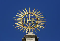 IHS sign. On Jesuits church. The church was built between 1623 and 1627. in Vienna, Austria Royalty Free Stock Image