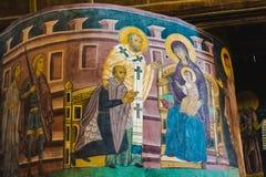 壁画-拉迪斯劳斯国王II下跪在保佑的圣母玛丽亚前的Jagiello 库存照片