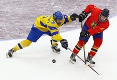 IIHF 2018 Ice Hockey U18 World Championship Div 1B. KYIV, UKRAINE - APRIL 20, 2018: Bogdan SEREDNITSKYY of Ukraine L fights for a puck with Zsolt SZABO of royalty free stock photos