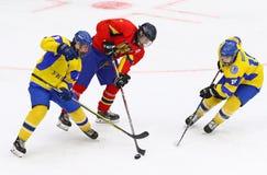 IIHF 2018 Ice Hockey U18 World Championship Div 1B. KYIV, UKRAINE - APRIL 20, 2018: Cristian BOLDIZSAR of Romania C fights for a puck with Stanislav SADOVIKOV L stock photos