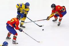 IIHF 2018 Ice Hockey U18 World Championship Div 1B. KYIV, UKRAINE - APRIL 20, 2018: Daniil DUIUN of Ukraine C fights for a puck with Remus GHEORGHE L and Tamas royalty free stock photos