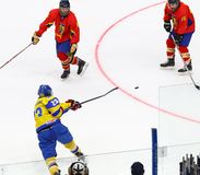 IIHF 2018 Ice Hockey U18 World Championship Div 1B. KYIV, UKRAINE - APRIL 20, 2018: Dmytro DANYLENKO of Ukraine shots a puck during the IIHF 2018 Ice Hockey U18 stock photography