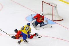 IIHF 2018 Ice Hockey U18 World Championship Div 1B. KYIV, UKRAINE - APRIL 20, 2018: Goalkeeper Arnold DEMETER of Romania defends his net during the IIHF 2018 Ice stock image
