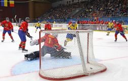 IIHF 2018 Ice Hockey U18 World Championship Div 1B. KYIV, UKRAINE - APRIL 20, 2018: Goalkeeper Arnold DEMETER of Romania missed a goal during the IIHF 2018 Ice stock photos