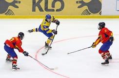 IIHF 2018 Ice Hockey U18 World Championship Div 1B. KYIV, UKRAINE - APRIL 20, 2018: Olexander PERESUNKO of Ukraine shots a puck during the IIHF 2018 Ice Hockey stock photo