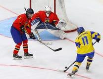 IIHF 2018 Ice Hockey U18 World Championship Div 1B. KYIV, UKRAINE - APRIL 20, 2018: Olexiy SYROTENKO of Ukraine shots a puck during the IIHF 2018 Ice Hockey U18 royalty free stock image
