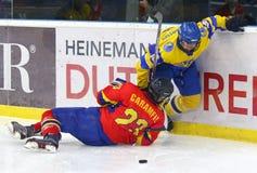 IIHF 2018 Ice Hockey U18 World Championship Div 1B. KYIV, UKRAINE - APRIL 20, 2018: Raul CARAMFIL of Romania L fights for a puck with Artem TSELOGORODTSEV of royalty free stock images
