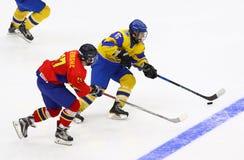 IIHF 2018 Ice Hockey U18 World Championship Div 1B. KYIV, UKRAINE - APRIL 20, 2018: Remus GHEORGHE of Romania L fights for a puck with Daniil DUIUN of Ukraine royalty free stock photos