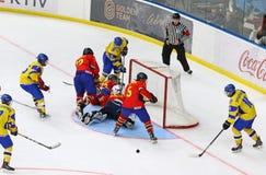 IIHF 2018 Ice Hockey U18 World Championship Div 1B. KYIV, UKRAINE - APRIL 20, 2018: Ukrainian players in yellow score a goal during the IIHF 2018 Ice Hockey U18 royalty free stock image