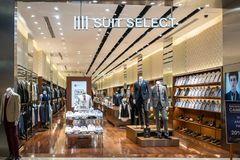 IIII Suit select shop at Mega Bangna, Bangkok, Thailand, Mar 19,. 2018 : Fashionable suit brand shop interior and display from entrance view. Shoe and shirt Royalty Free Stock Photos