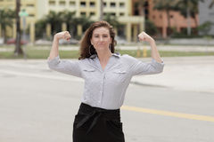 IImage of a businesswoman flexing her arms Royalty Free Stock Photography